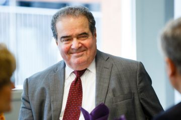 Supreme Court Justice Antonin Scalia smiles while having lunch at the School of Law building in downtown Minneapolis on October 20, 2015.