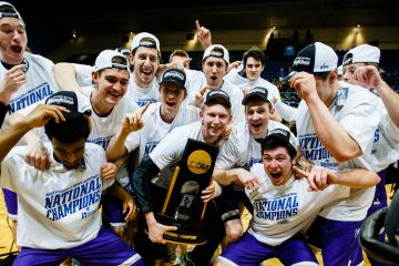 The Tommies pose with their trophy following the NCAA Division III men's basketball championship game March 19, 2016 at the Salem Civic Center in Salem, Va. The University of St. Thomas Tommies defeated the Benedictine University Eagles by a final score of 82-76.