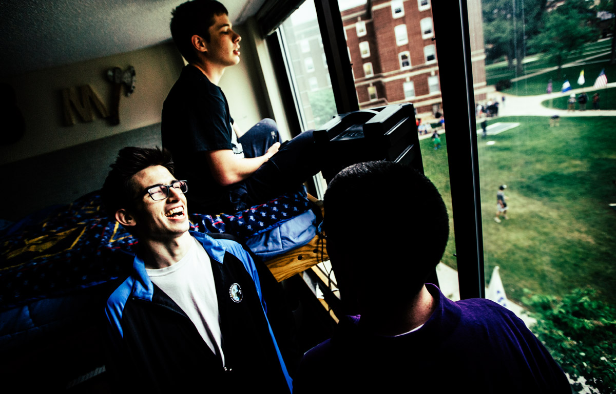 Seminarians Paul Hedman (on bed), Kevin Hufnagel (laughing) and Antonio Gutierrez operate the announcers' booth inside the SJV dorm.