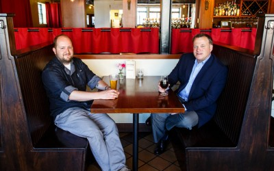Chris Ikeda (Entrepreneurship), left, chef and owner of Lake & Irving Restaurant & Bar, and Reid Hellgren ('97, MBA), former partner in Parella, pose for a portrait at Lake & Irving in Minneapolis on May 18, 2016.