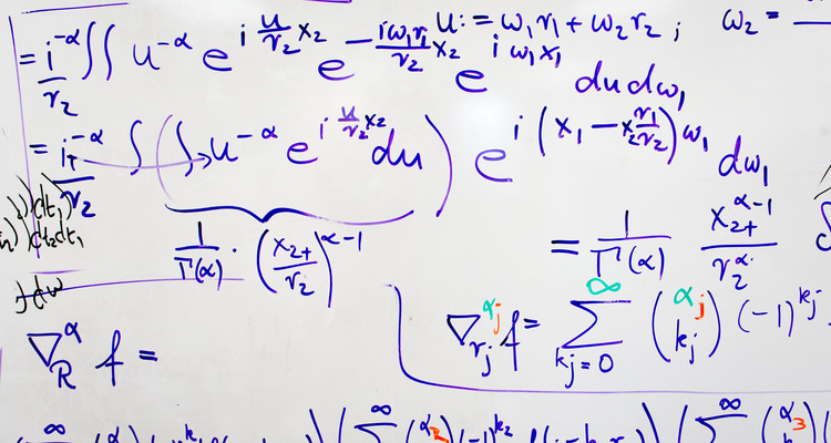 A white board covered with a lengthy math equation in the office of Department of Mathematics Chair and Professor Patrick Van Fleet in O'Shaughnessy Science Hall. Van Fleet was working on an equation that is used for computer image modeling. Photo by Mark Brown.
