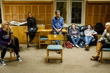 Students act in an improv exercise during an English class in the Leather Room in the O'Shaughnessy-Frey Library Center on Oct. 28, 2015. Members of the Wonderlust Theater participated in a residency on campus with several different classes and programs, working with English and Theater students on improvisation skills and script writing. English professor Amy Muse, back right, and Wonderlust Theater co-Artistic Director Alan Berks, middle back (wearing blue shirt) look on. Photos by Mark Brown.
