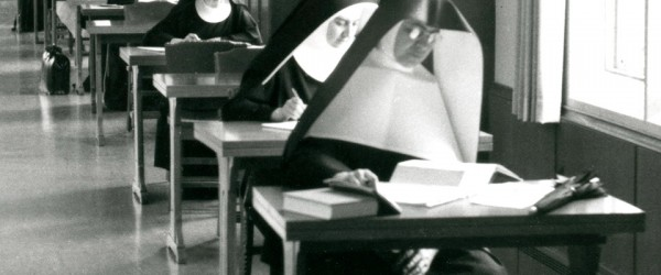 Members of several different female religious order study in the O'Shaughnessy Library at the College of St. Thomas, 1960.