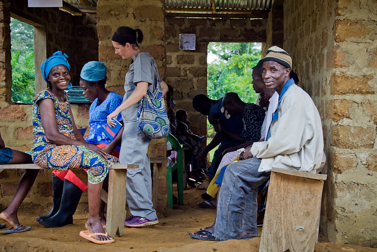 Patients wait at an outreach clinic provided by Last Mile Health and a county health team in the remote community of Boe-Geewon.