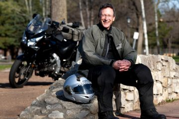 "University Relations Director of News Services Jim Winterer and avid motorcyclist poses for a photograph near South Mississippi River Boulevard in Saint, Paul, Minn., on Friday, April 9, 2010. Winterer is photographed for the ""How We Work, How We Play"" section of the Spring 2010 edition of St. Thomas Magazine."