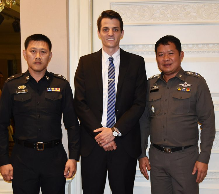 Benjamin Hargrove, center, stands with police officers in Thailand. The International Justice Mission, with which Hargrove interned, was hosting a training session in partnership with police to help community leaders identify and report child sexual abuse and exploitation.