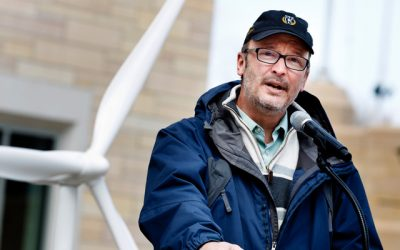 Vice President for mission and communications and journalism professor Mark Neuzil speaks during a ceremony recognizing St. Thomas as the largest purchaser of wind energy in the state April 25, 2013 on the John P. Monahan Plaza. St. Thomas buys 82 percent of its electricity from wind power. The university also earned recognition from the Environmental Protection Agency for winning the College and University Green Power Challenge in the Minnesota Intercollegiate Athletic Conference.