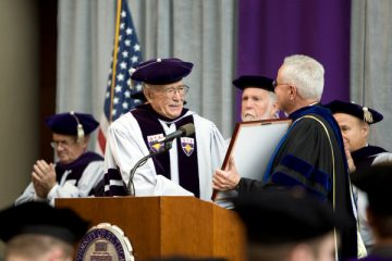 University president Father Dennis Dease, right, awards Guy Schoenecker the Thomas Aquinas Medallion during the University of St. Thomas School of Law Commencement at the School of Law in Minneapolis, Minn., on Saturday, May 9, 2009.