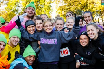 UST President Dr. Julie Sullivan poses for a group photo with students participating in the annual Wellness 5K on Summit Avenue in St. Paul on October 17, 2015.