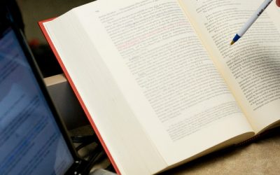 A School of Law student looks through a textbook during an Administrative law class lecture.Taken April 9, in a School of Law classroom.