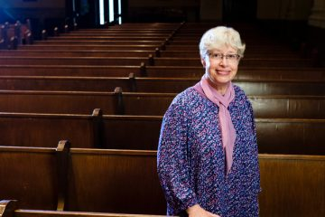 Philosophy professor Sandra (Sandy) Menssen stands for a portrait in the Chapel of St. Thomas Aquinas, October 27, 2016. Photo by Mike Ekern.