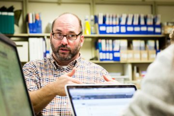 Scott Odman, Business librarian, talks with a student in the Charles J. Keffer Library in Opus Hall on November 29, 2016, in  Minneapolis.