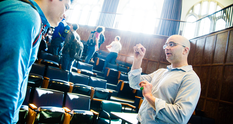 School of Engineering professor John Abraham talks with a student following a class in the John Roach Center for the Liberal Arts auditorium March 7, 2016. Photo by Mike Ekern '02
