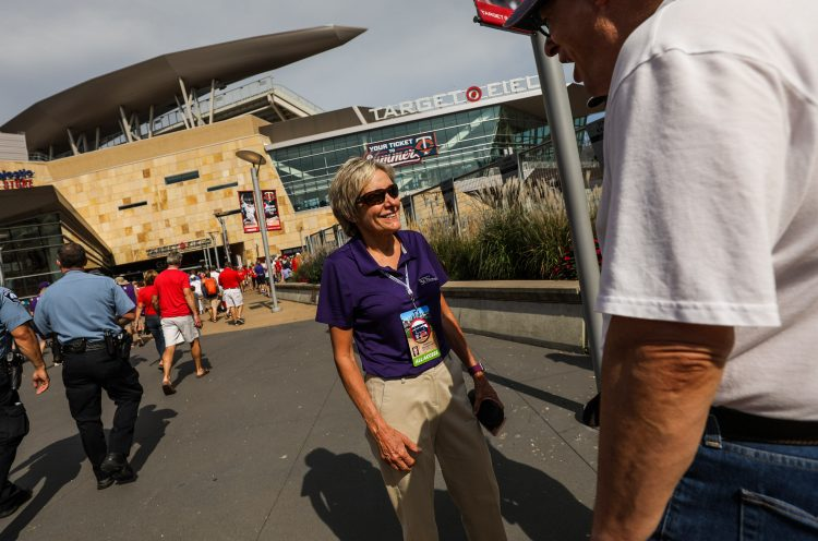 President Julie Sullivan greeted fans on the Target Field plaza before Tommie-Johnnie.