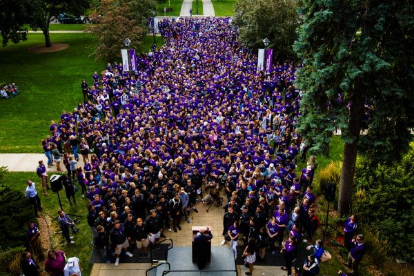 The freshman class waits outside the arches before March Through the Arches.