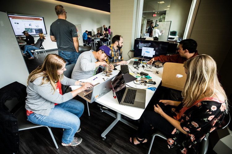 A team works on its bot during the US Bank Make-a-Thon on September 19, 2017 in the Makerspace in the Anderson Student Center in St. Paul. Teams comprised of personnel from US Bank and IBM, along with St. Thomas undergraduate students, competed during the two-day event to program an IBM TJ Bot to provide college students with financial assistance