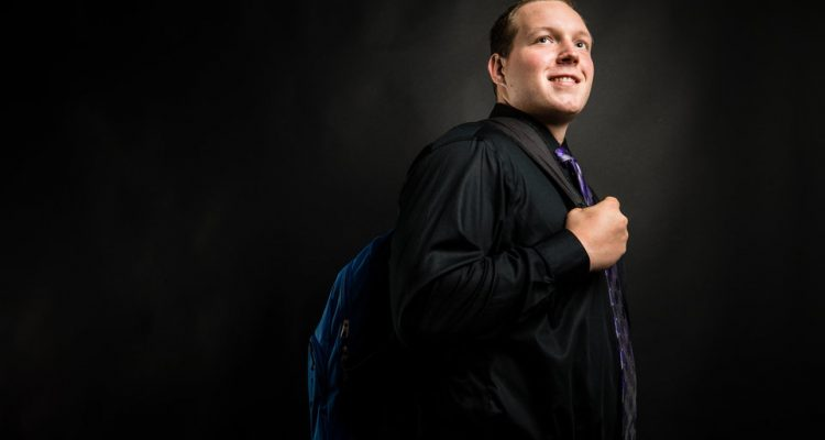 Dustyn Montgomery, an Excel! scholar, stands with his backpack.