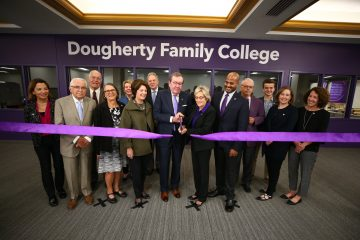 Mike Dougherty and president Julie Sullivan cut the symbolic ribbon, dedicating Dougherty Family College on Oct. 13.
