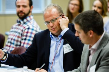 "Judge Maurice (Mo) Fahnestock tries out the ""Elate"" menu reading system during the Fowler Business Concept Challenge November 20, 2015 in Schulze Hall. The competition sees students auditioning their ideas for a business in front of panels of judges with the hopes of winning the $10,000 first prize."