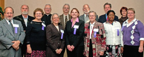 Quarter Century Club inductees: Top row, from left to right: Tom Hodgson, Father Dennis Dease, president of the university, Don LaMagdeleine, Tom Mega, Tony Erickson and MaryLou Schmidt. Bottom row: Jerry Schwartz, Jeanne Buckeye, Brenda Powell, Janet Gould, Sister Paul Therese Saiko, Theresa Namusisi and Gayle Lamb. Not pictured: Linda Halverson, Helen Hunter, Marcos Macias, Richard Schuler, Glenn Sherer, Jane Spatenka, Roger Stowell and and Heekyung Youn.