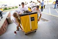 Volunteers help new students move into Dowling Hall