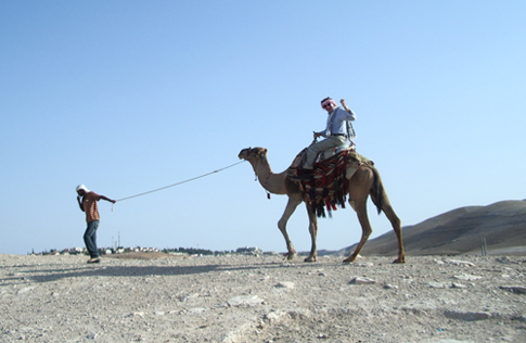 Fr. Dease riding on a camel