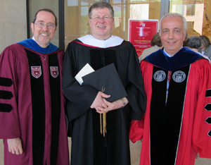 New honorary degree recipient Father Jan Michael Joncas, center, with Provost Thomas Forget (left) and President Anthony Cernera of Sacred Heart University.