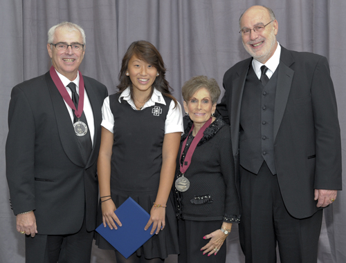 Frank (left) and Judy Sunberg received a Saint Elizabeth Ann Seton Award from the National Catholic Education Association. Richard Engler (right), president and principal of Cretin-Derham Hall, and Fayte Moua, a Cretin-Derham senior who received a received a NCEA scholarship in the Sunbergs' name, also attended the event.