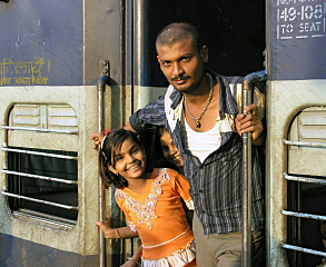"""Ben Michel was the winner of St. Thomas' 2009 International Photo Contest for this picture of a proud father and his daughter taken in a New Delhi, India, train station. """"As always, I first asked if I could take their picture,"""" Michel said, """"and they were happy to oblige. The trains in India may not be the most accommodating, but the people sure are."""""""