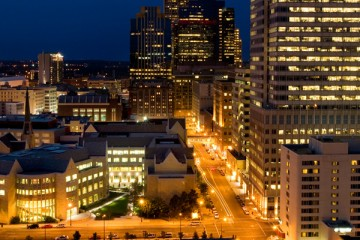 Schulze Hall (left) and Terrence Murphy Hall (right) are shown with the downtown Minneapolis skyline at night August 14, 2007. Aerial photo taken from the roof of Loring Green Tower.