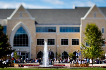 Students fill the John P. Monahan Plaza in front of the Anderson Student Center September 18, 2012. The fountain is featured and the out-of-focus effect is caused by the use of a tilt-shift lens.