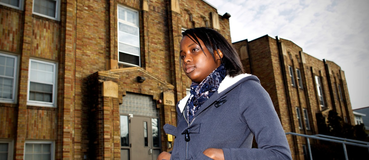 Olivia Mpanga steps out of her Grand Avenue apartment building to head to class.