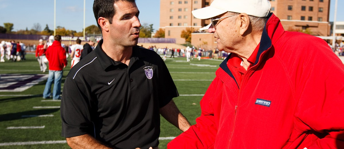 St. Thomas head coach Glenn Caruso (left) shakes hands with Saint John's head coach John Gagliardi in 2008. (Photo by Mike Ekern '02)