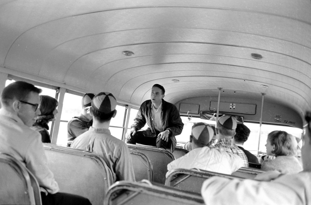 Tommies, sporting classic beanies, ride the bus to Saint John's for the 1964 tilt. The Tommies lost that game 0-24.