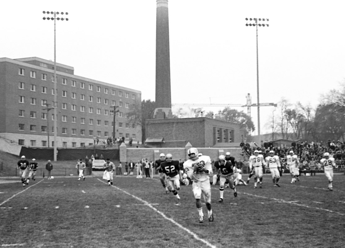 Some things, like a campus under construction, never change. Here in the background of the 1969 game, O'Shaughnessy Educational Center is being built. The Tommies lost 11-33.