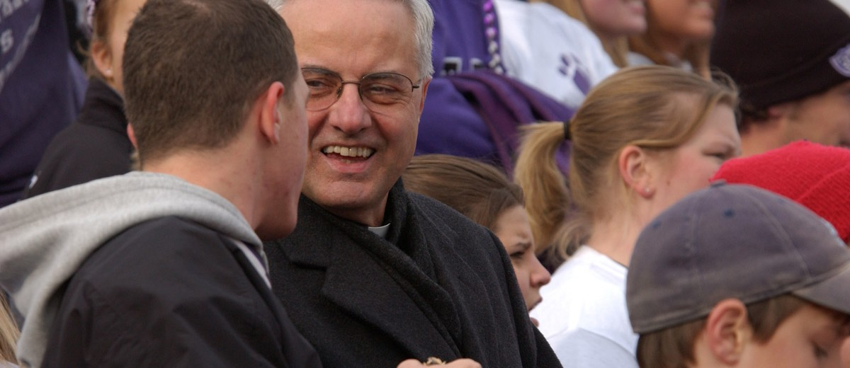 Father Dease made an appearance at the 2003 game, a 12-15 St. Thomas loss.
