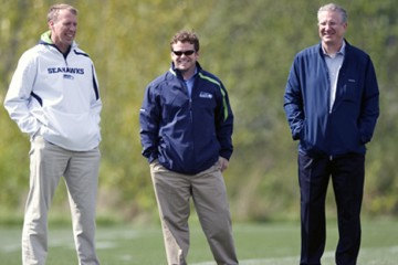 The rise of the Seattle Seahawks has coincided with 2010 arrival of St. Thomas alum John Schneider, center, as the team's general manager and executive vice president. (Seattle Seahawk's photo.)