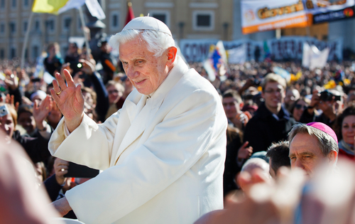 Pope Benedict XVI waves at some of the 300,000 attendees of his final papal audience before resigning. (Photo by Mark Brown)