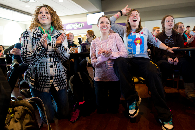 Students, from left, Olivia Bennett, Andrea Diamond and Laurel Eyer react as they watch the announcement of a new pope in Scooter's March 13. (Photo by Mark Brown)