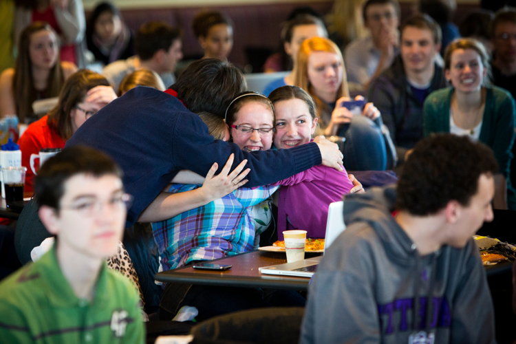 Students react as they watch the announcement of a new pope in Scooter's March 13. (Photo by Mark Brown)