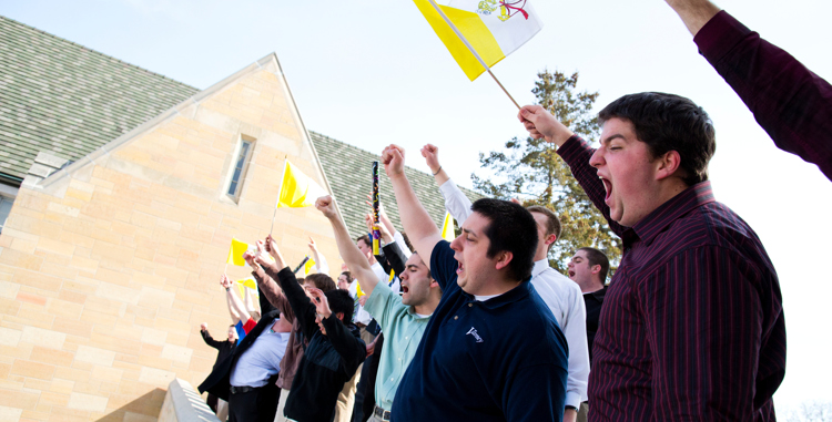 St. John Vianney seminarians celebrate on the Arches after the election of Cardinal Jorge Mario Bergoglio as the 266th Pope on March 13.. (Photo by Mark Brown)