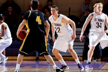 Noah Kaiser (seen here against Gustavus in the MIAC men's basketball championship game) hit a 3-point shot late in the game against Wheaton to put the Tommies ahead for good 63-62. The Tommies travel to Salem, Va., to play in the Elite Eight.