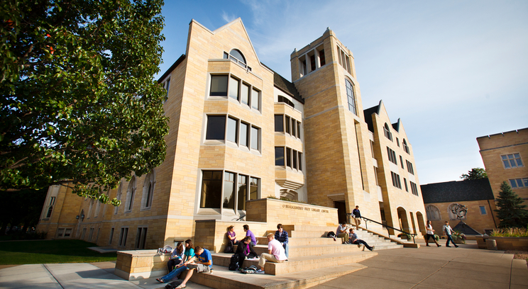 Students study and talk outside the O'Shaughnessy-Frey Library Center. Photo by Mark Brown.