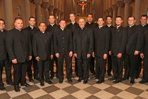 Completing their studies for the priesthood at the St. Paul Seminary School of Divinity this year are, from the left: Adam Westphal, Jacob Greiner, John Drees, Fabian Moncada, Brian Park, James Peterson, Andrew Brinkman, Seminary Rector Monsignor Aloysius Callaghan, Manuel Gomez, Leonard Andrie, Andrew Jaspers, Joah Ellis, Adam Hamness, Andrew Stueve and Luke Marquard. Spencer Howe, who completed his studies in Rome for the Archdiocese of St. Paul and Minneapolis, is not pictured.