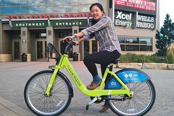 Julie Rech, who recently graduated with a major in geography, tries of the NiceRide bikes that are now available to St. Thomas students, staff and faculty at a steep discount.
