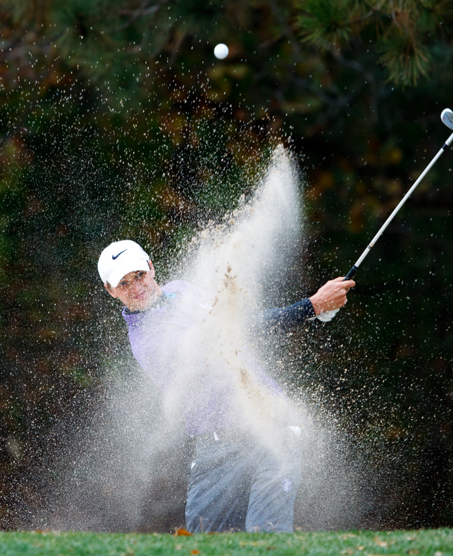 Brian Parkhurst hits out of a sand trap during the third and final day of the men's MIAC golf championship Oct. 8, 2012 at Bunker Hills Golf Course in Coon Rapids, Minn. (Photo by Mike Ekern '02)