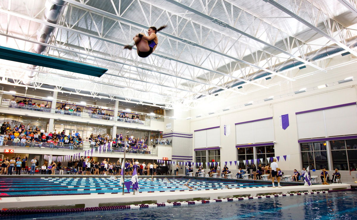 Katie Becker dives Dec. 7, 2012 during the St. Thomas Invite at the Anderson Athletic and Recreation Complex Aquatic Center. (Photo by Mike Ekern '02)