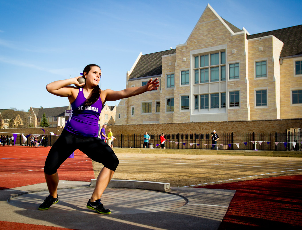 Allie Voigt throws in the shot put at the women's MIAC outdoor track and field championship on May 10, 2013 in O'Shaughnessy Stadium. (Photo by Mark Brown)