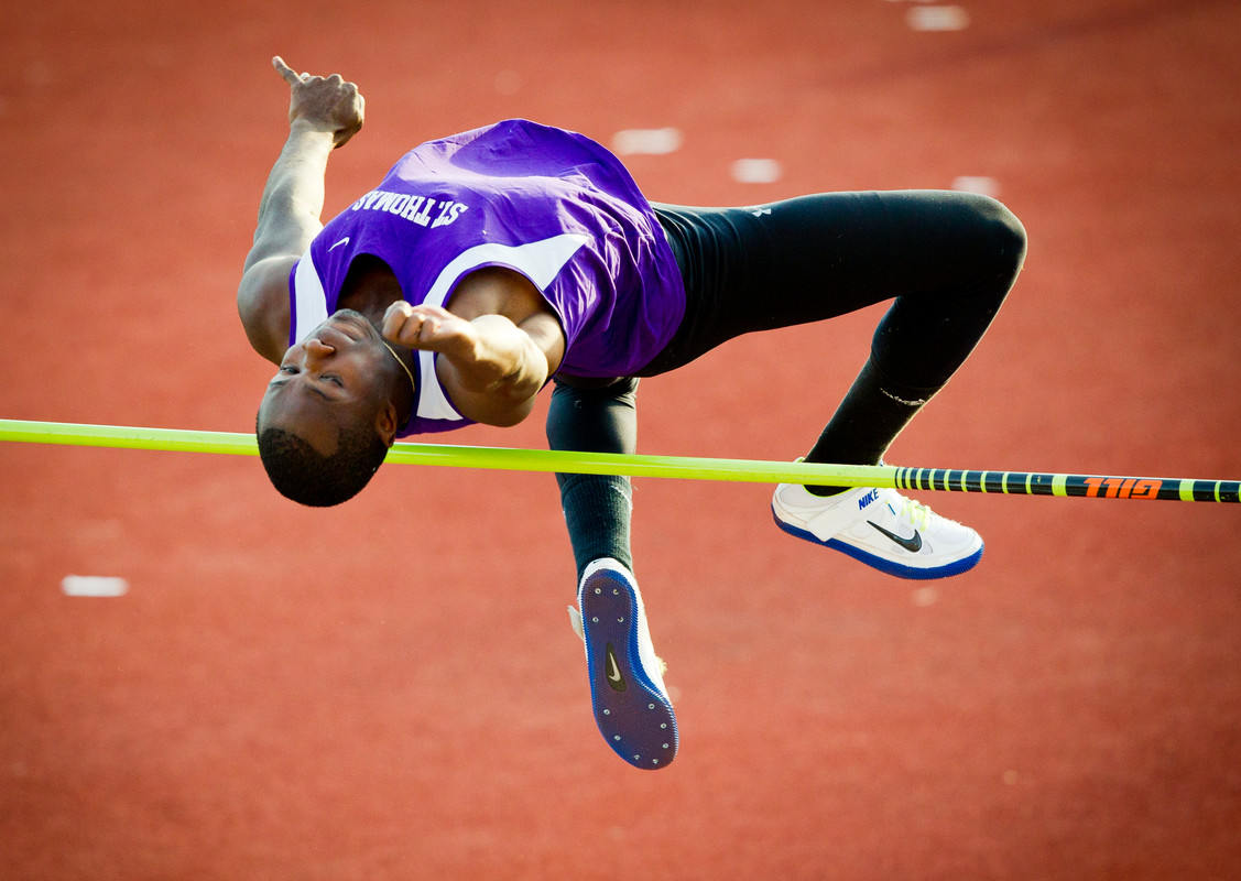 Eyo Ekpo competes in the high jump during the men's MIAC outdoor track and field championship on May 10, 2013 in O'Shaughnessy Stadium. The Tommie men took first place. (Photo by Mark Brown)