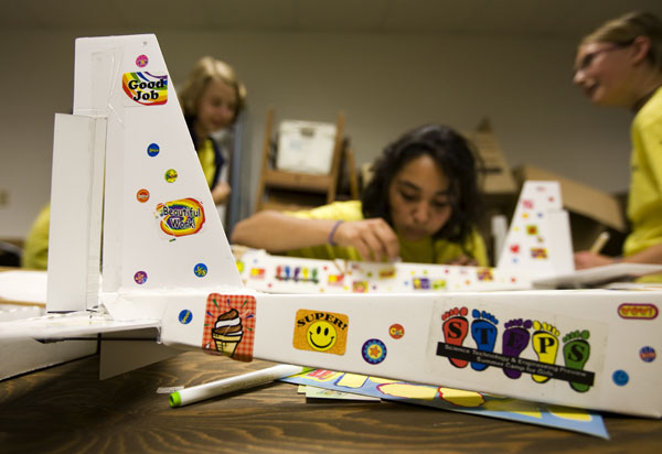 STEPS campers prepare their airplanes for fly night. (St. Thomas photo by Mike Ekern.)